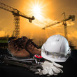 helmet and construction equipment with building and crane agains