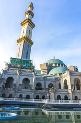 The wilayah mosque with reflection and blue skies background