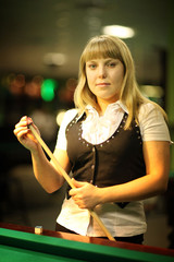 girl plays billiards