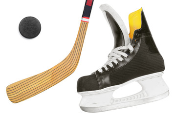 Hockey skates, stick and puck