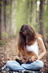 woman playing with a small dog