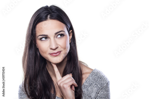 portrait of beautiful smiling and thoughtful girl on white