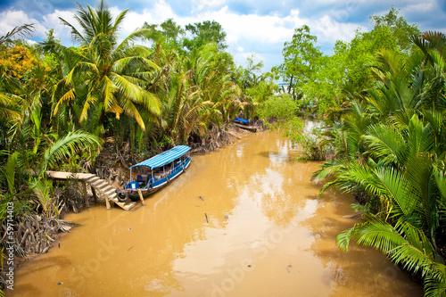 Leinwandbild Motiv Cannal with Boats in Mekong delta, Ben Tre, Vietnam.