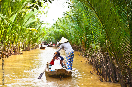 Leinwandbild Motiv A famous tourist destination is  Ben Tre village  in Mekong delt