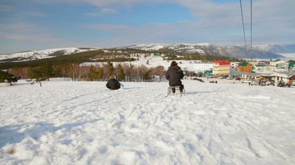 Sledging at the ski resort