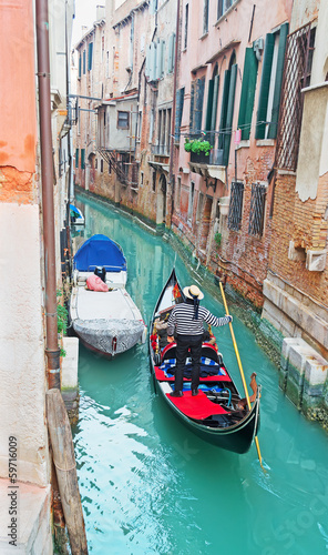 gondola in a narrow canal
