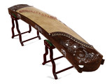 Wooden dulcimer traditional musical instrument.