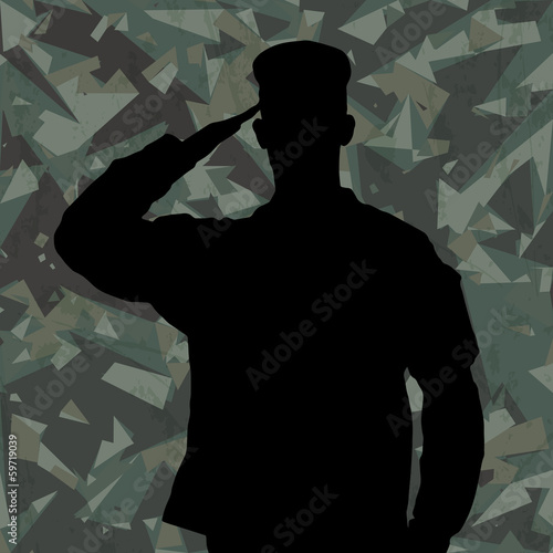 Saluting soldier's silhouette on a green army camouflage backgro
