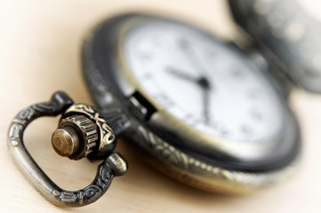 Antique pocket watch on desk