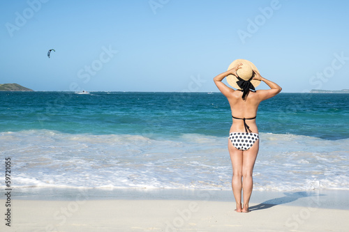 Back of a Woman in Black Polka Dot Bikini on a Caribbean Beach