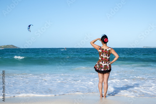 Woman Wearing Short Sun Dress Standing on a Caribbean Beach