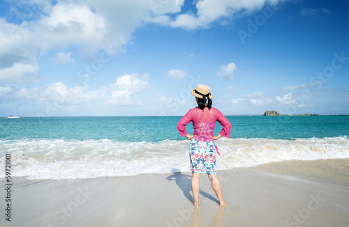 Water in Sun Dress Standing in Front of the Caribbean Ocean