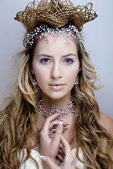 Beauty young snow queen in fairy flashes