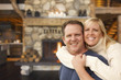 Affectionate Couple at Rustic Fireplace in Log Cabin