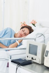 Female patient sleeping in medical bed