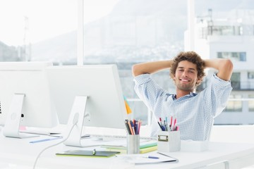 Relaxed casual business man with computer in bright office