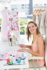 Portrait of a female fashion designer working on fabrics