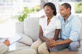 Young couple listening to salesman on the couch