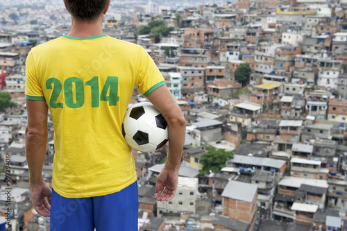 canvas print picture Brazil 2014 Football Player Standing with Soccer Ball Favela Rio