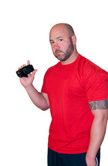 Handsome bald man with video camera looking at camera, isolated