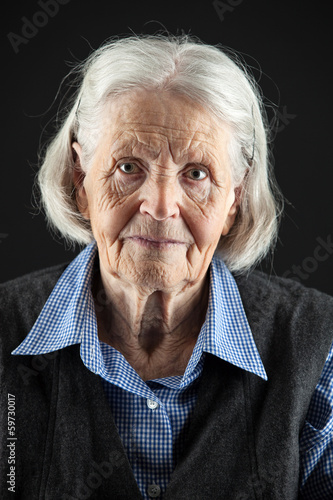 Portrait of a calm senior woman looking at the camera.