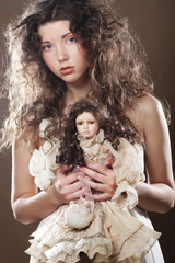 young woman with doll