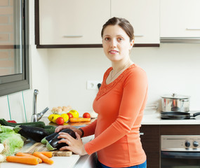 woman with  eggplants in her kitchen
