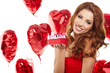 Valentine's Day. Beautiful smiling woman with a gift