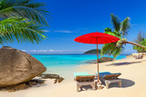 Fototapety Tropical beach scenery with deck chairs in Thailand