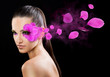Beautiful woman on black background with flower