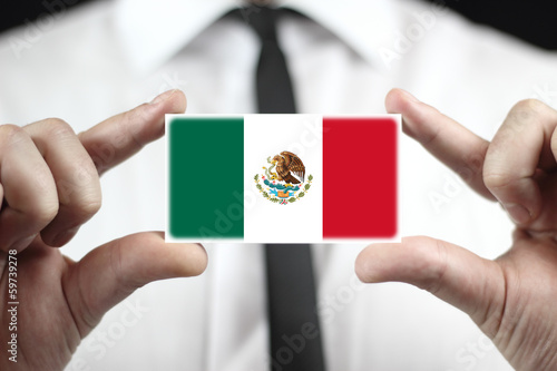 Businessman holding a business card with Mexico Flag