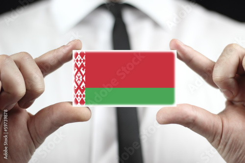 Businessman holding a business card with Belarus Flag