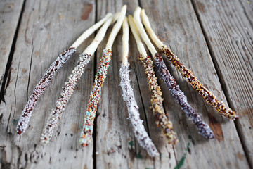 Breadsticks with chocolate and sprinkles, sweet dessert