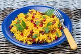 couscous salad with curry, dried cranberries and herbs
