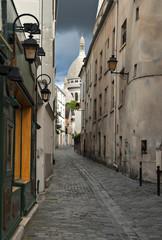 Narrow medieval street, Monmartre hills, Paris, France