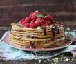Stack of freshly baked pancakes with chocolate
