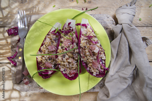 Boat of brown rice with red radicchio and speck