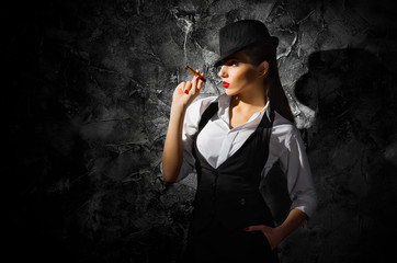 Dangerous and beautiful criminal girl with cigar
