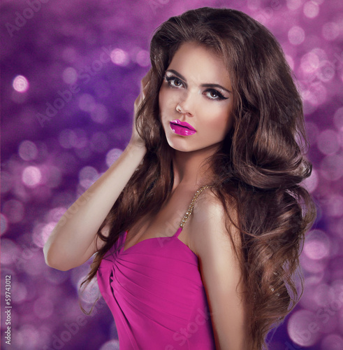 Glamour Fashion Woman Portrait. Long Wavy Hair and Sexy Makeup.