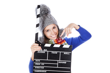 Little girl with a clapperboard