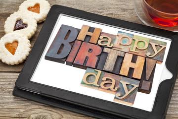 Happy birthday on digital tablet