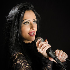 Attractive Woman Singing With Microphone