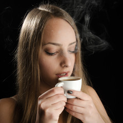 Young Woman Holding Hot Coffee Cup