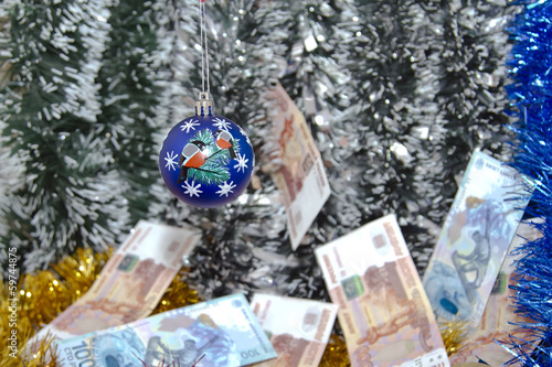 Christmas tinsel and banknotes of rubles.