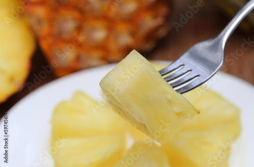 Sliced pineapple with fork