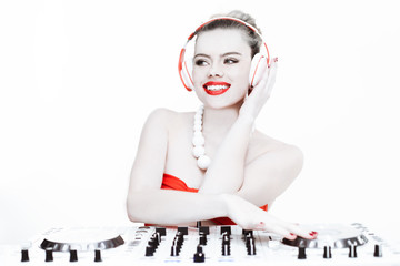 Sexy female DJ mixing music using the turntable