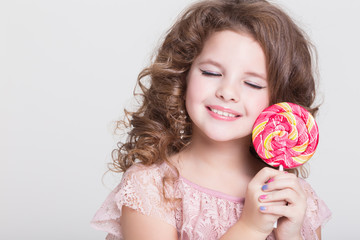 Little child with candy lollipop Funny baby girl