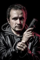 Housebreaker, thief, armed man with black leather jacket, danger