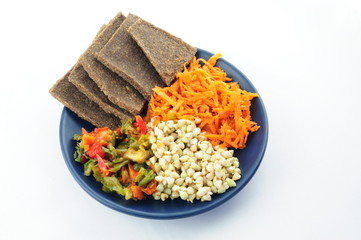 Buckwheat, flax breads,  pepper and carrot on the plate