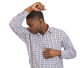 Man smelling his armpit